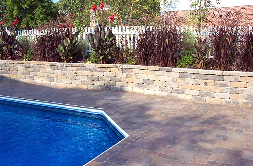 Installing retaining walls and patios for greater for Pool design company radom polen